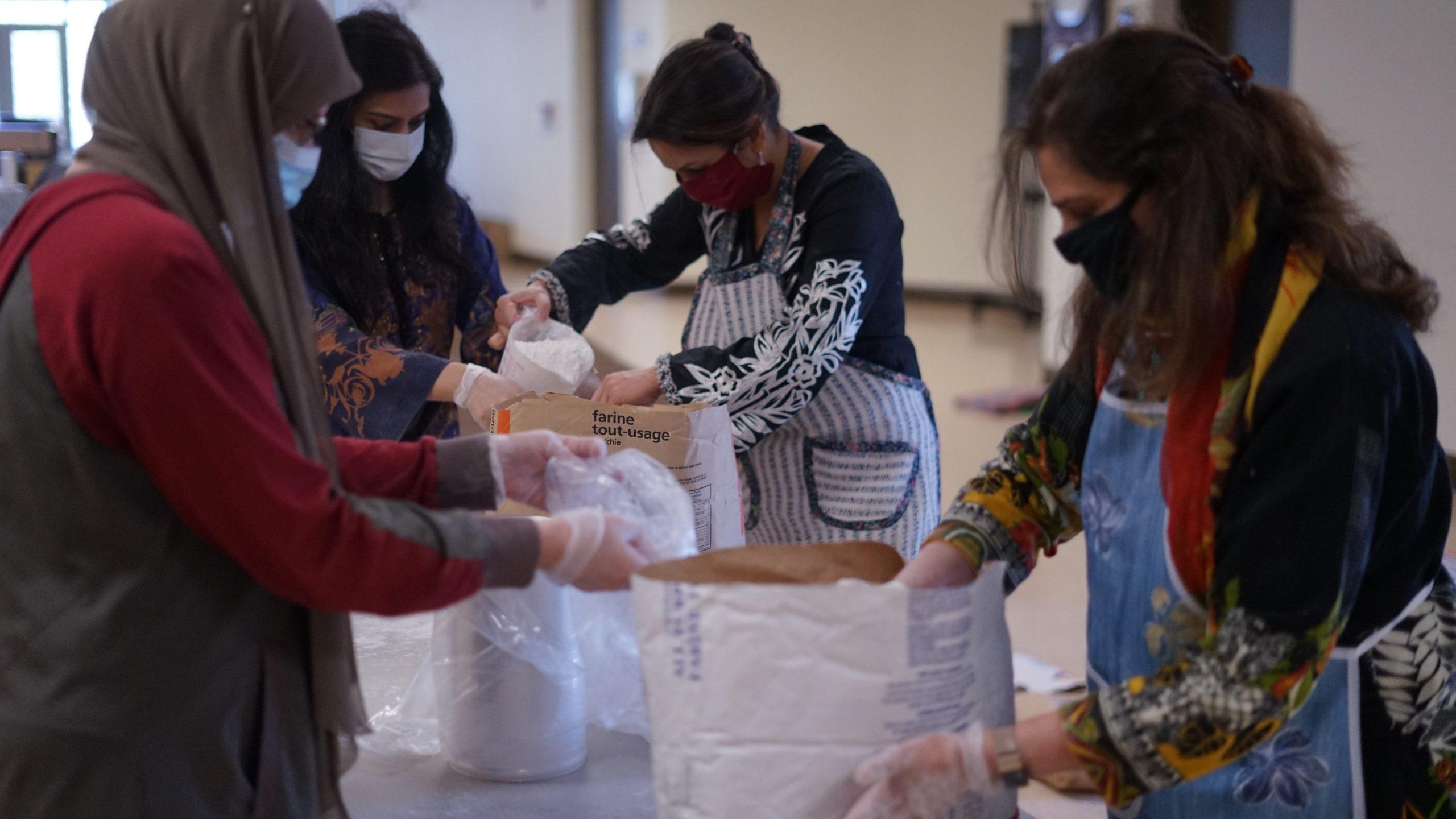 Volunteers pack aid bags