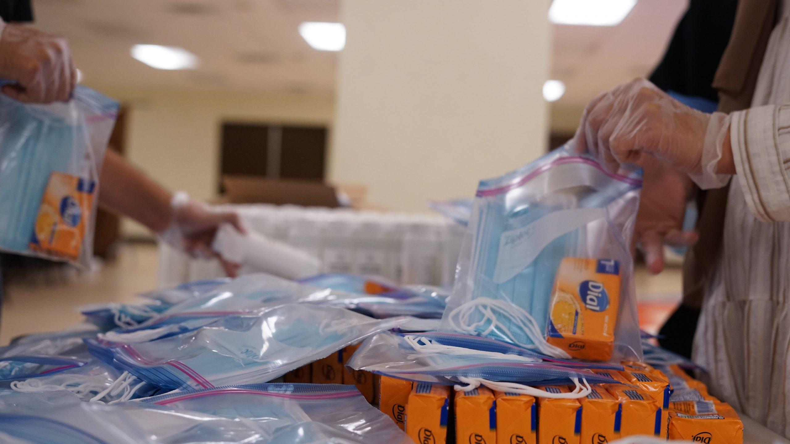 Volunteers fill aid bags