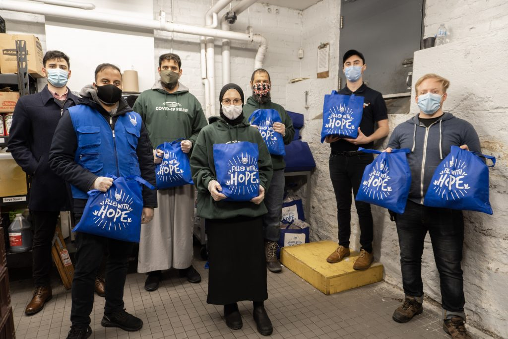 """A group of people holding """"Filled with Hope"""" bags"""