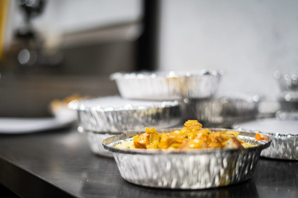 Cooked meals in tin pans