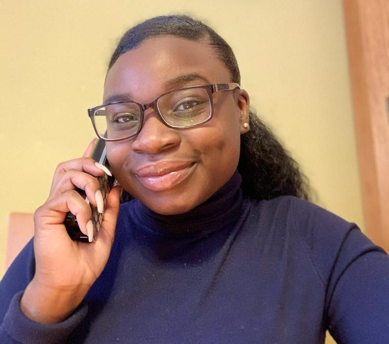 Photo of a woman on the phone